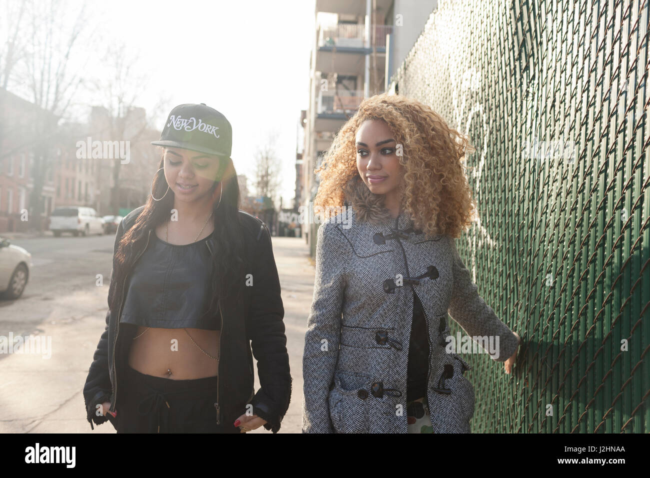 Portrait of two stylish young women - Stock Image