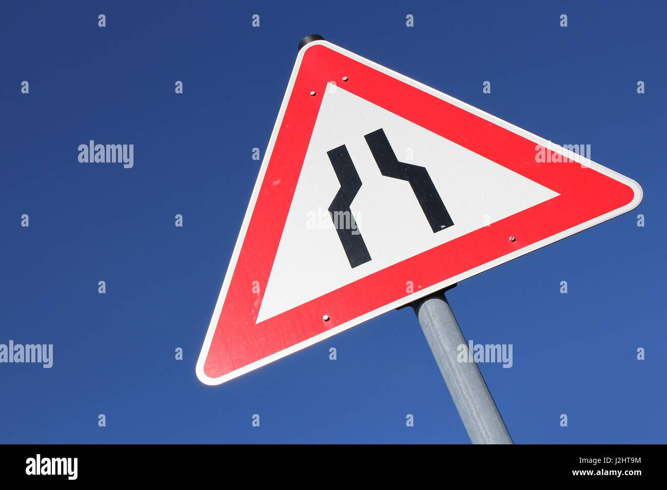 German road sign: road narrows, both sides, narrow, bottleneck, construction site, roadworks, warning, triangular - Stock Image