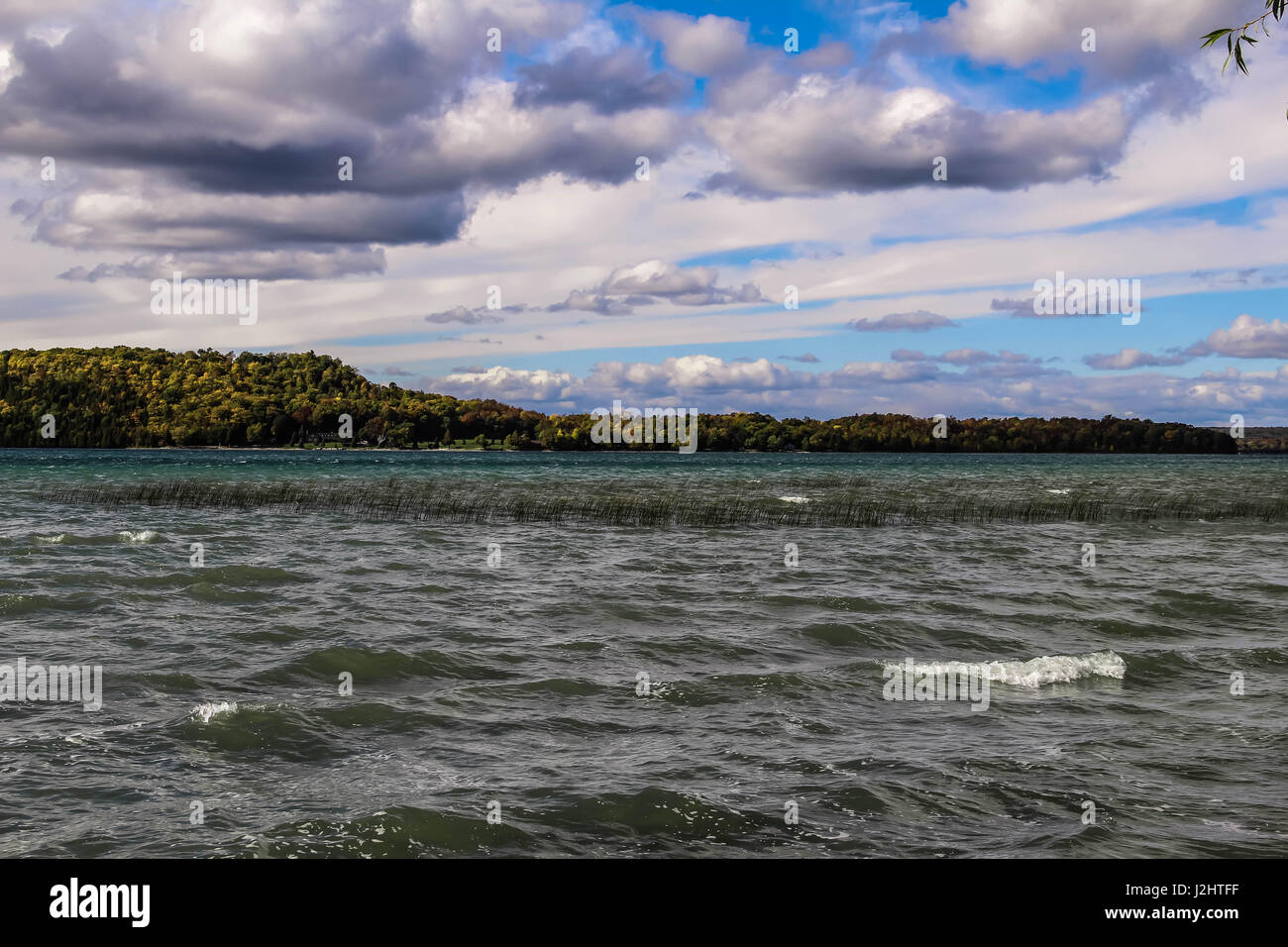 Dramatic cloudy sky and gray water scenic background, Canada - Stock Image