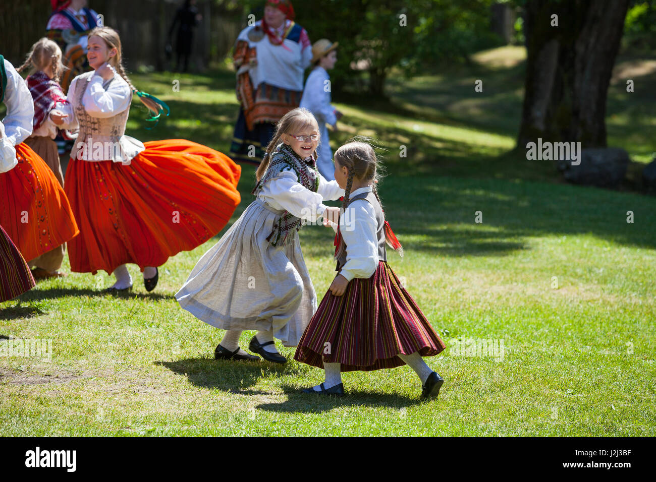 RIGA, LATVIA - 12 JUN 2016: Latvian dancers - small girls in national costumes. Cultural event in Latvian Ethnographic - Stock Image