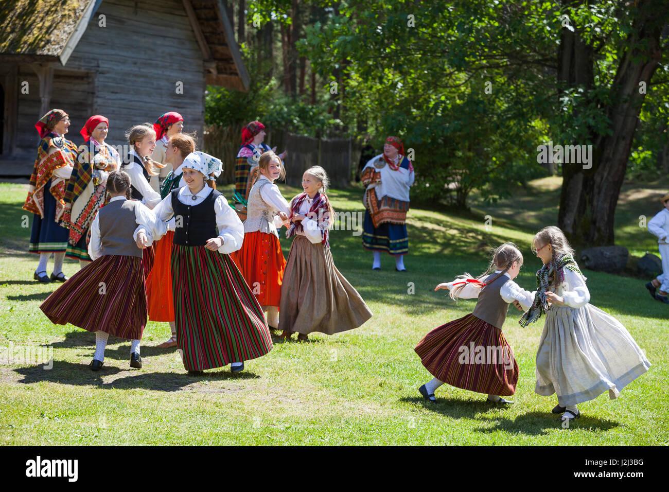 RIGA, LATVIA - 12 JUN 2016: Latvian dancers in national costumes. Cultural event in Latvian Ethnographic Museum. - Stock Image