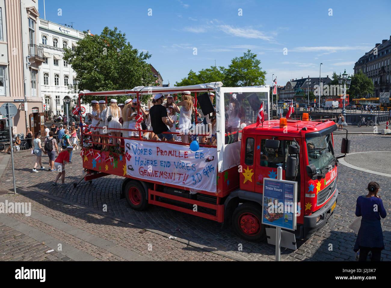 COPENHAGEN, DENMARK - 26 JUN 2016: Students celebrate their high school graduation in funny truck - Stock Image