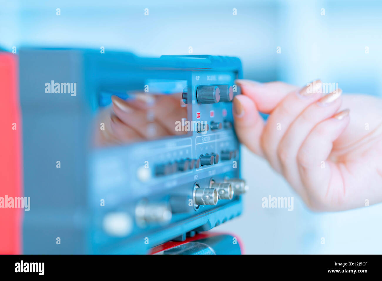 Person using control panel. - Stock Image