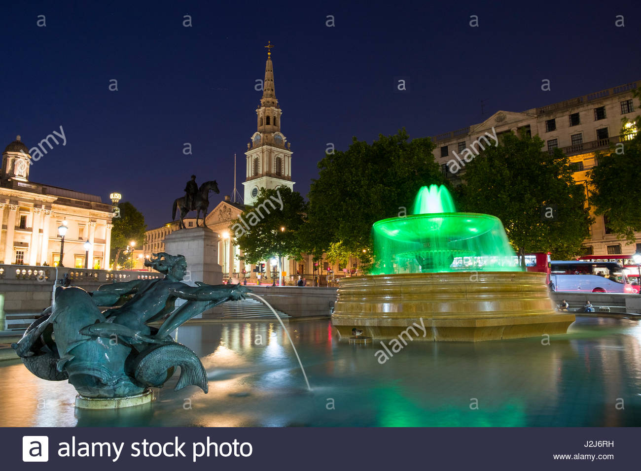 Water fountain and water sculpture in Trafalgar Square with St Martin-in-the-Fields church in the background at - Stock Image