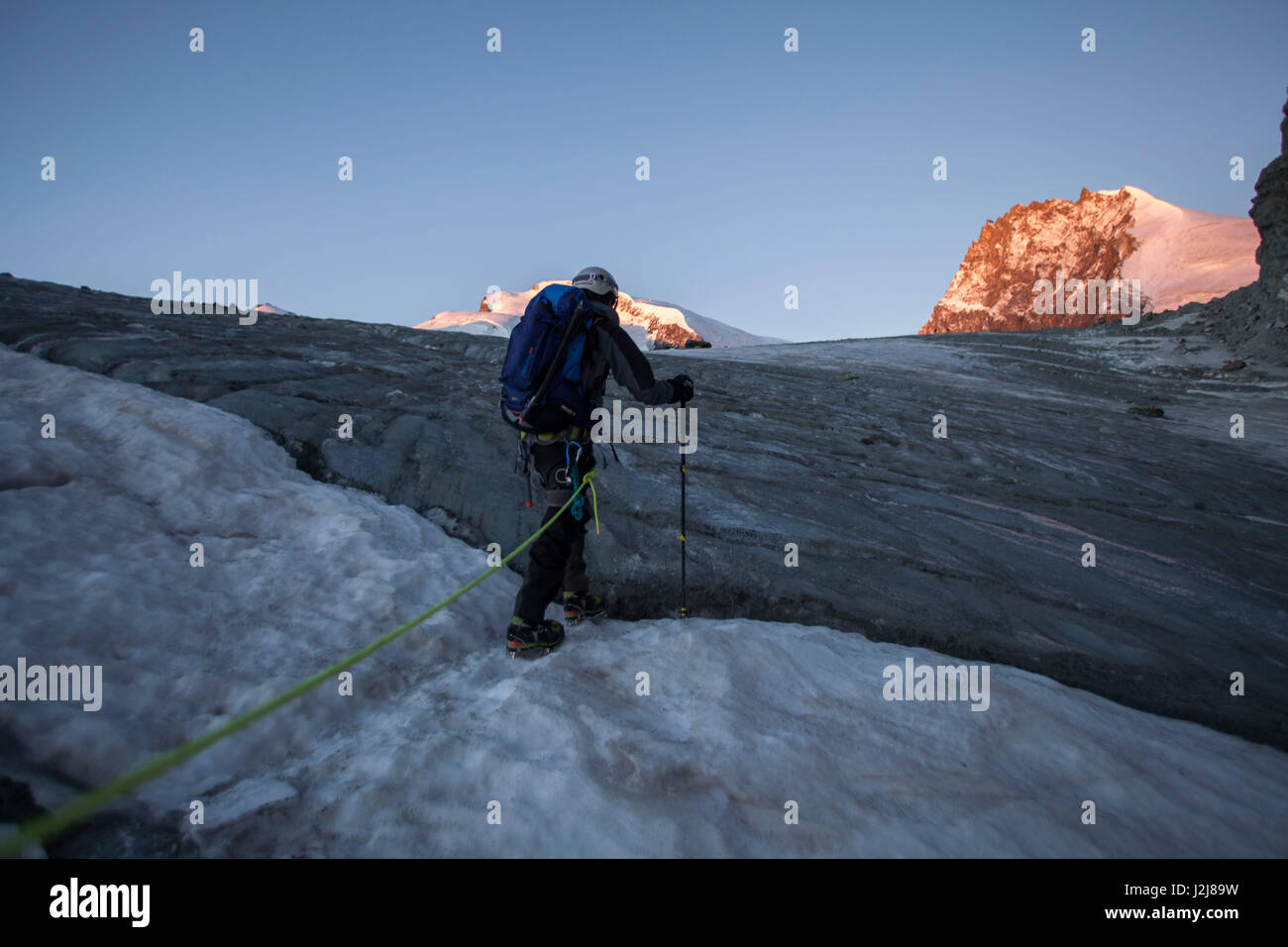 1 person, mountaineer in front of crevasse, climbing iron, ice, glacier, climb, approach, the sun, summit, loneliness, - Stock Image