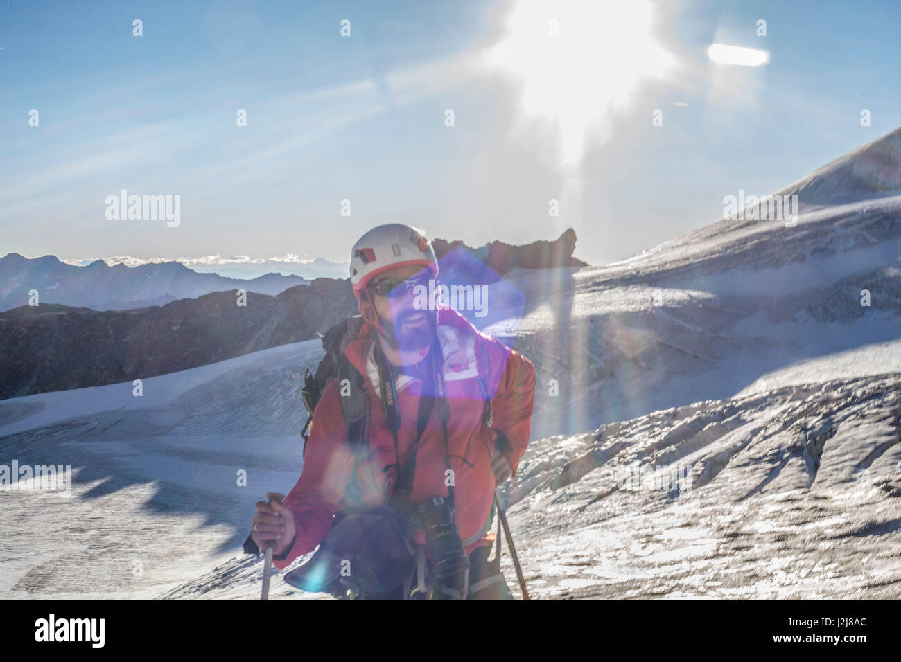 1 person, looking into camera, ice, glacier, climb, approach, flare, the sun, summit, loneliness, silence, glacier, - Stock Image