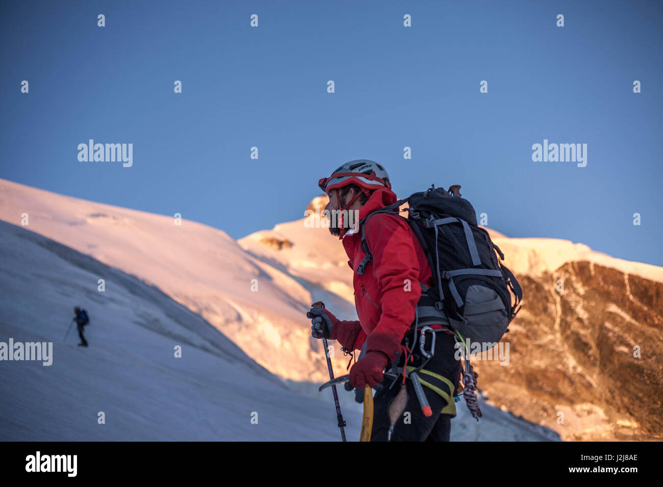 1 person, trekking, way up to the summit, approach, view forward, scenery, summit, glacier, silence, adventure, - Stock Image
