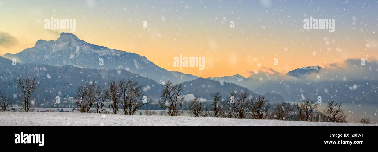 panorama of Schafberg (mountain) over the Mondsee (lake) at sunrise, Austria, Salzkammergut, winter Stock Photo