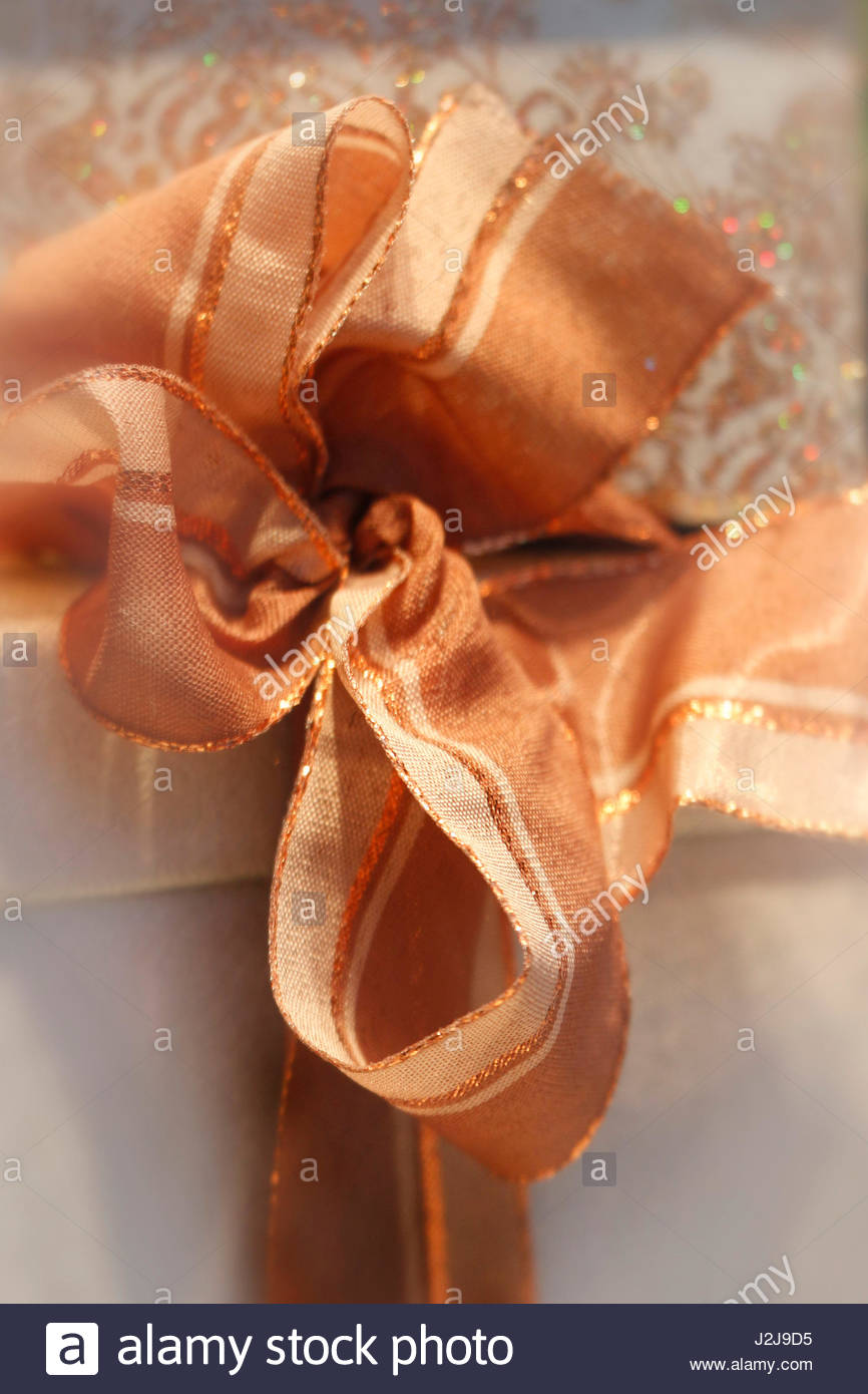 Ornage Christmas ribbon with gold - Stock Image
