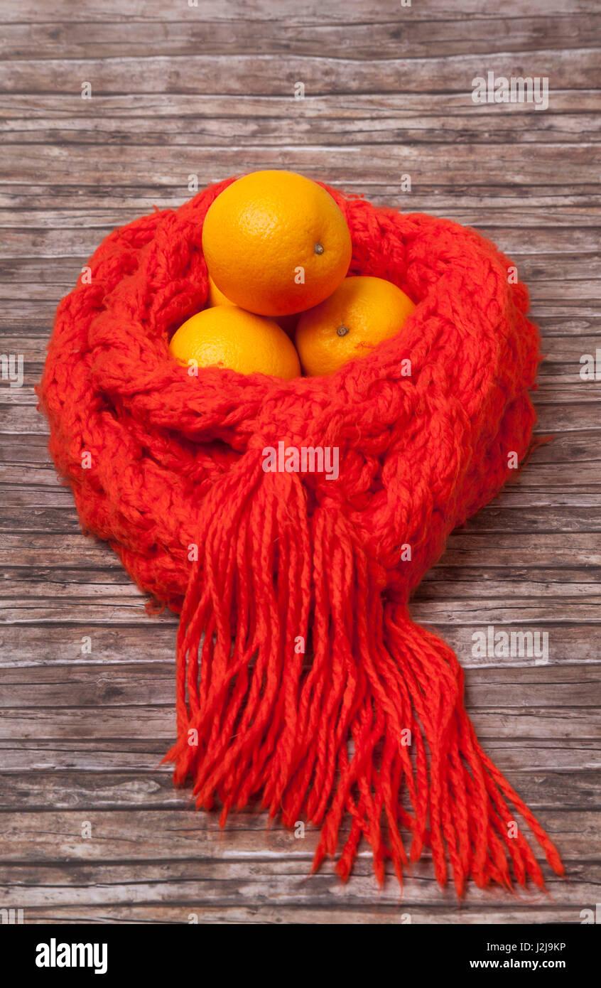 Defences, precaution, medicine, health, oranges, scarf - Stock Image