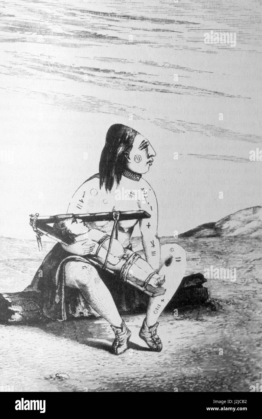 Historic drawing of a Chinook woman with tattoos holds an infant strapped inside a cradleboard used to flatten infants - Stock Image
