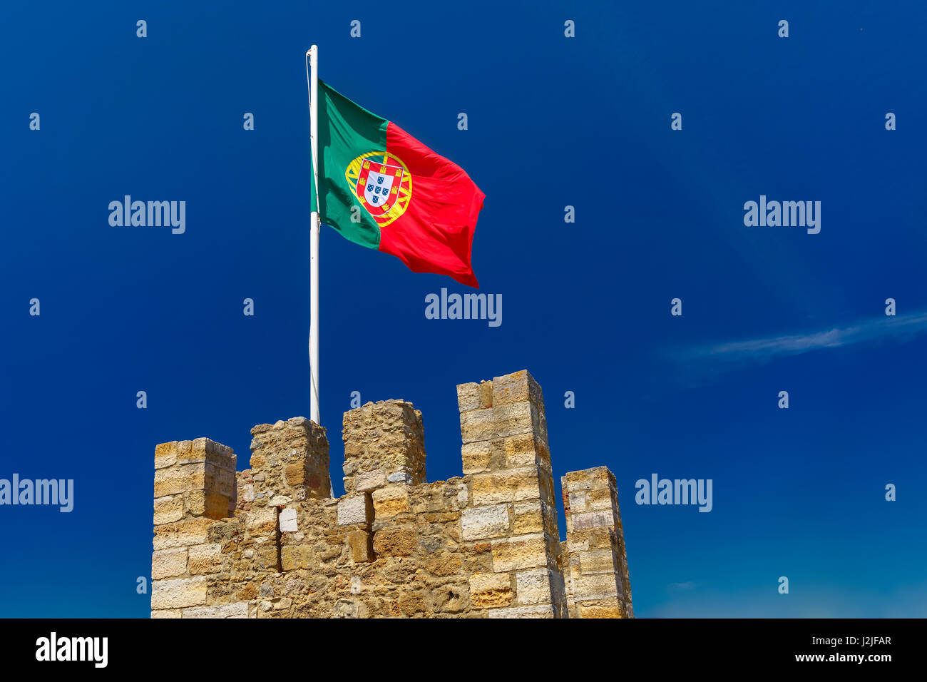 Portuguese flag on fortress wall, Lisbon, Portugal - Stock Image
