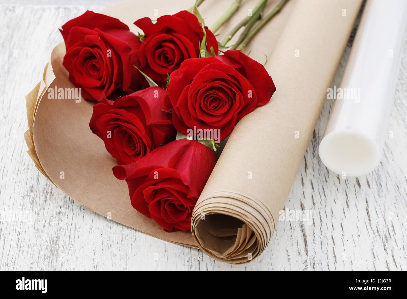 Paper or plastic stretch film as wrapping for red rose flowers copy paper or plastic stretch film as wrapping for red rose flowers copy space mightylinksfo