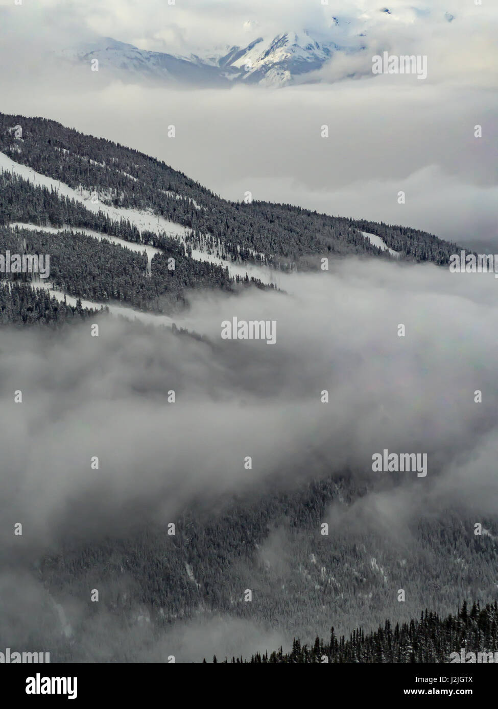 Foggy view of mountains in Whistler Canada. - Stock Image