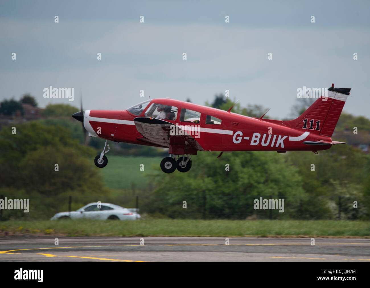 Piper PA-28-161 G-BUIK takes off from North Weald airfield - Stock Image
