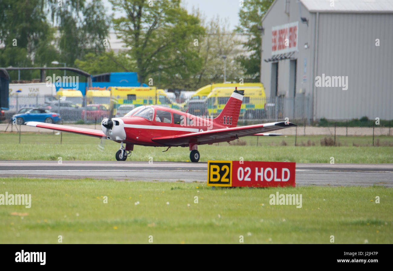 Piper PA-28-161 G-BUIL takes off from North Weald airfield - Stock Image