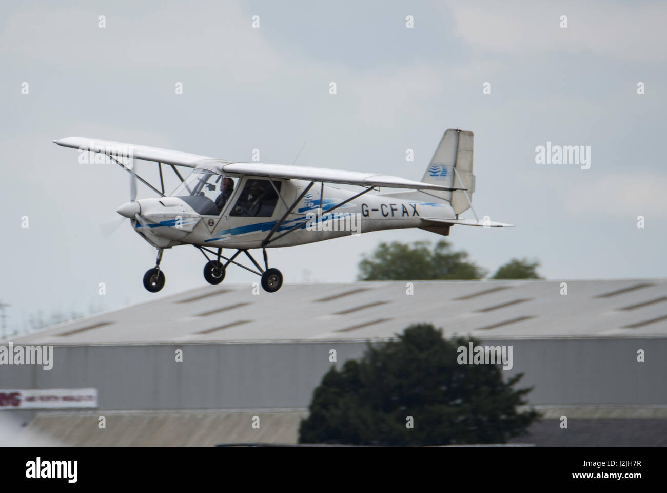 G-CFAX Ikarus Comco C-42 (0712-6933) comes in to land at North weal airfield - Stock Image