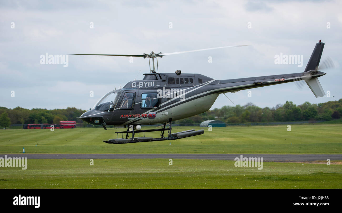 Bell 206B Jet Ranger III, helicpter takes off at North Weald Airfield - Stock Image