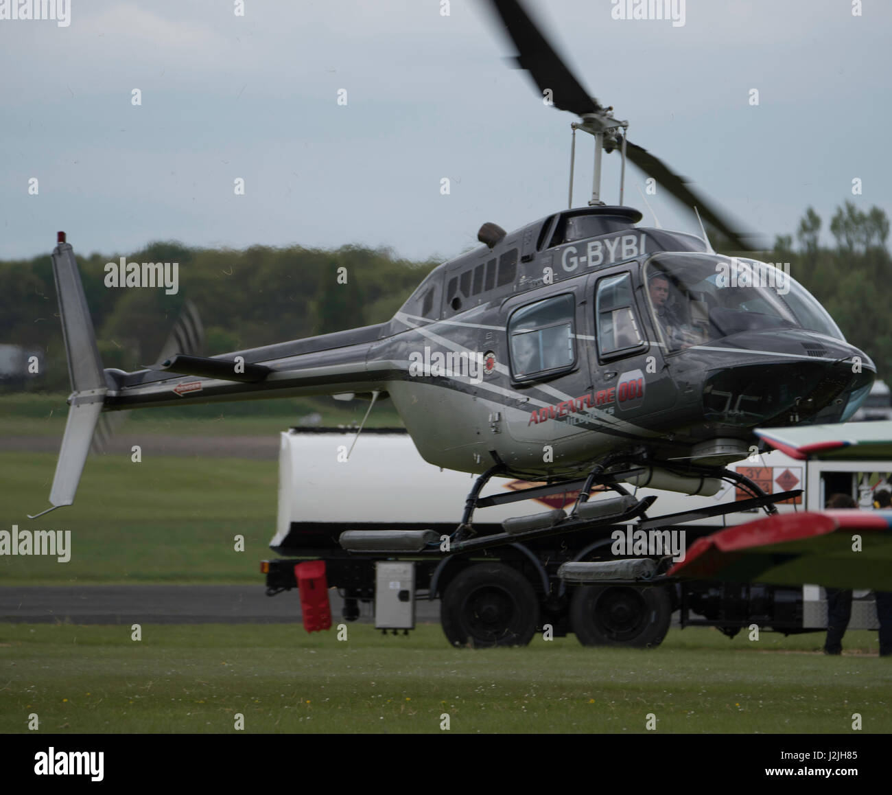 Bell 206B Jet Ranger III, helicopter takes off at North Weald Airfield - Stock Image