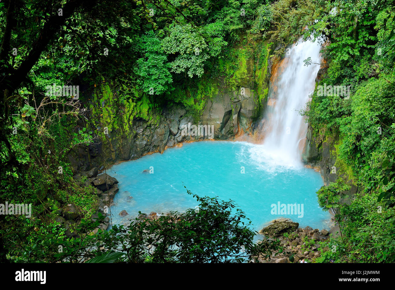 Waterfall with the blue waters of the Rio Celeste in Volcán Tenorio National Park, Costa Rica, Central America - Stock Image