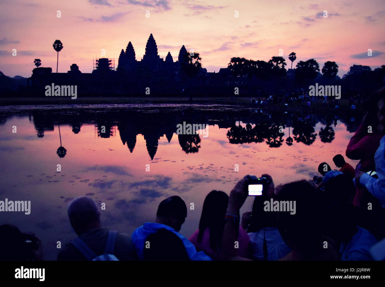 Beautiful sunrise colors over Angkor Wat ancient stone temple ruins, Cambodia - Stock Image