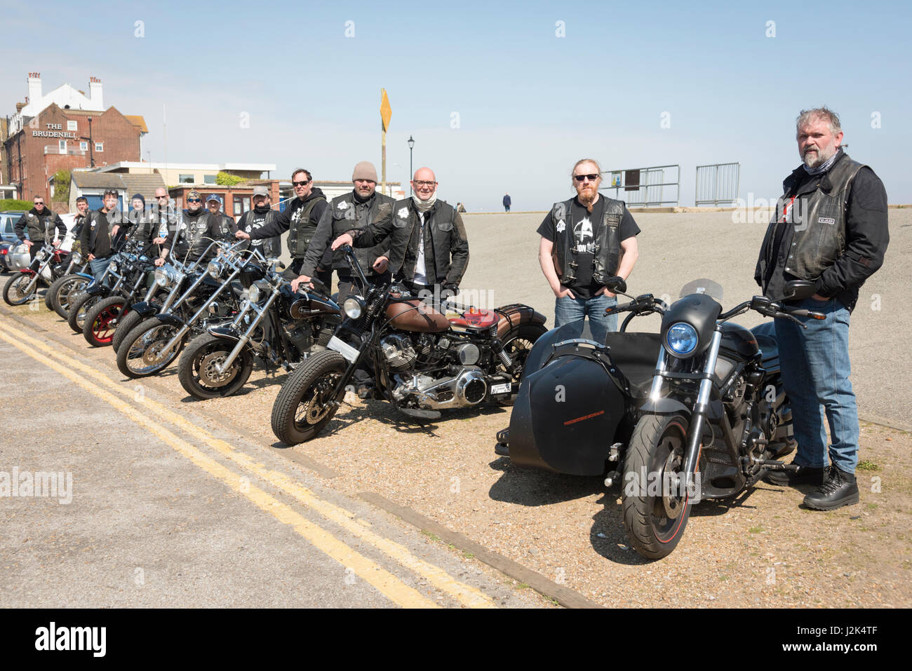 Aldeburgh Suffolk UK, 29th April 2017. Motorcyclists from the Chopper Club Germany pose on the seafront in bright - Stock Image