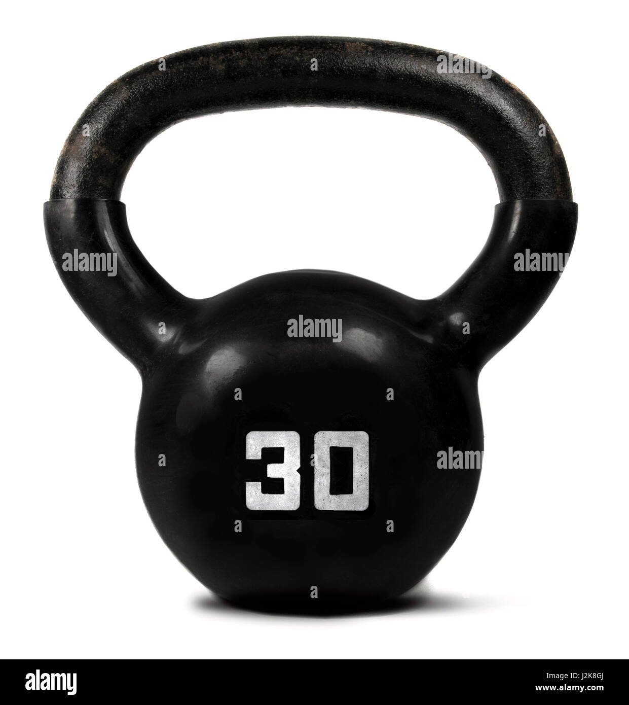 Black kettlebell weight on a white background. - Stock Image