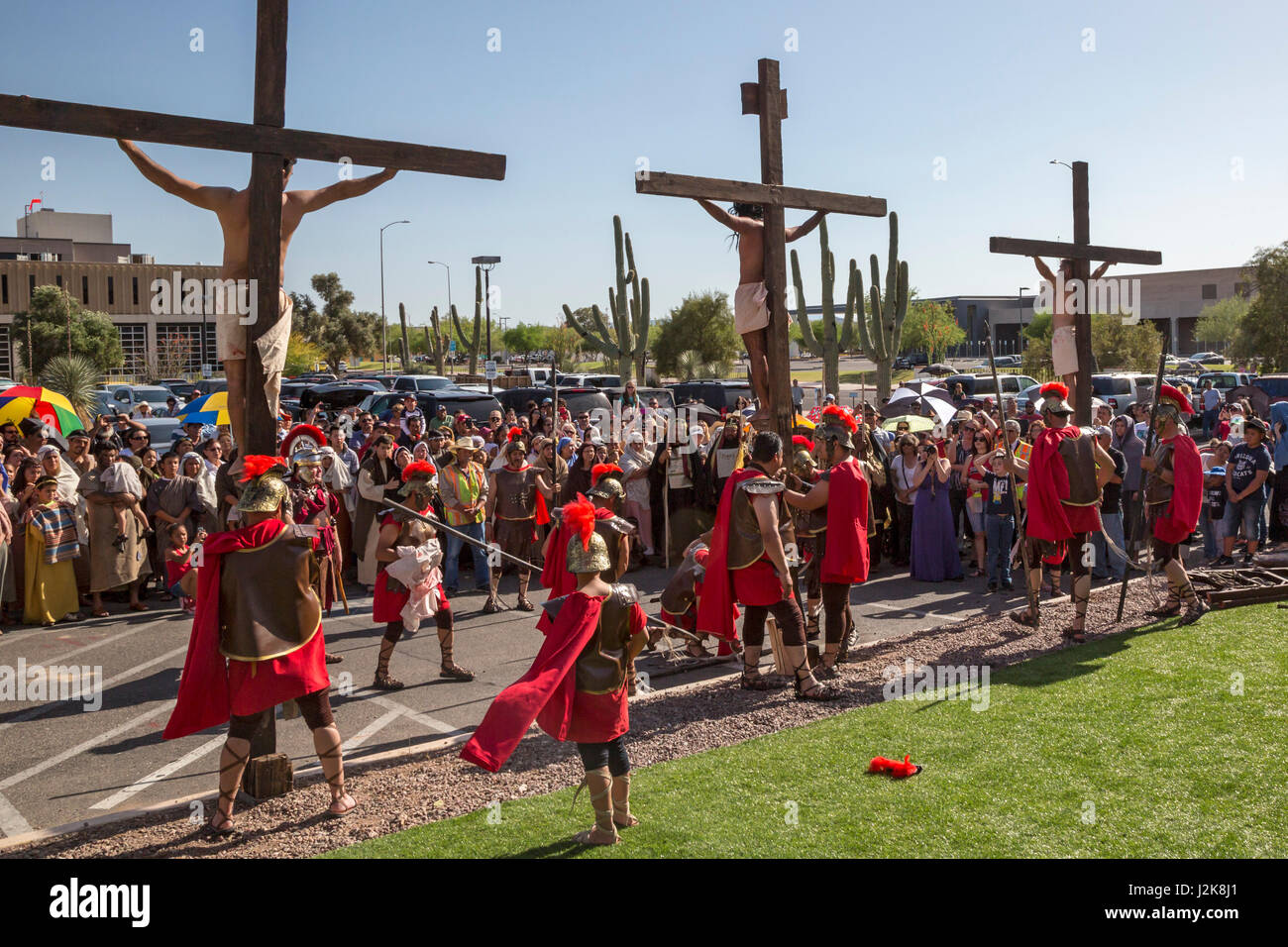 Tucson, Arizona - An annual Good Friday procession reenacts the crucifixion of Jesus. The procession begins at San - Stock Image