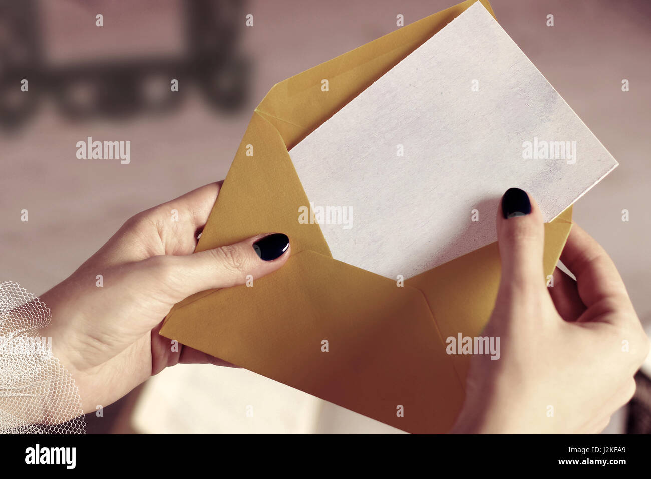 Closeup of woman hand opening envelope with mockup business card closeup of woman hand opening envelope with mockup business card blank letter reheart Gallery