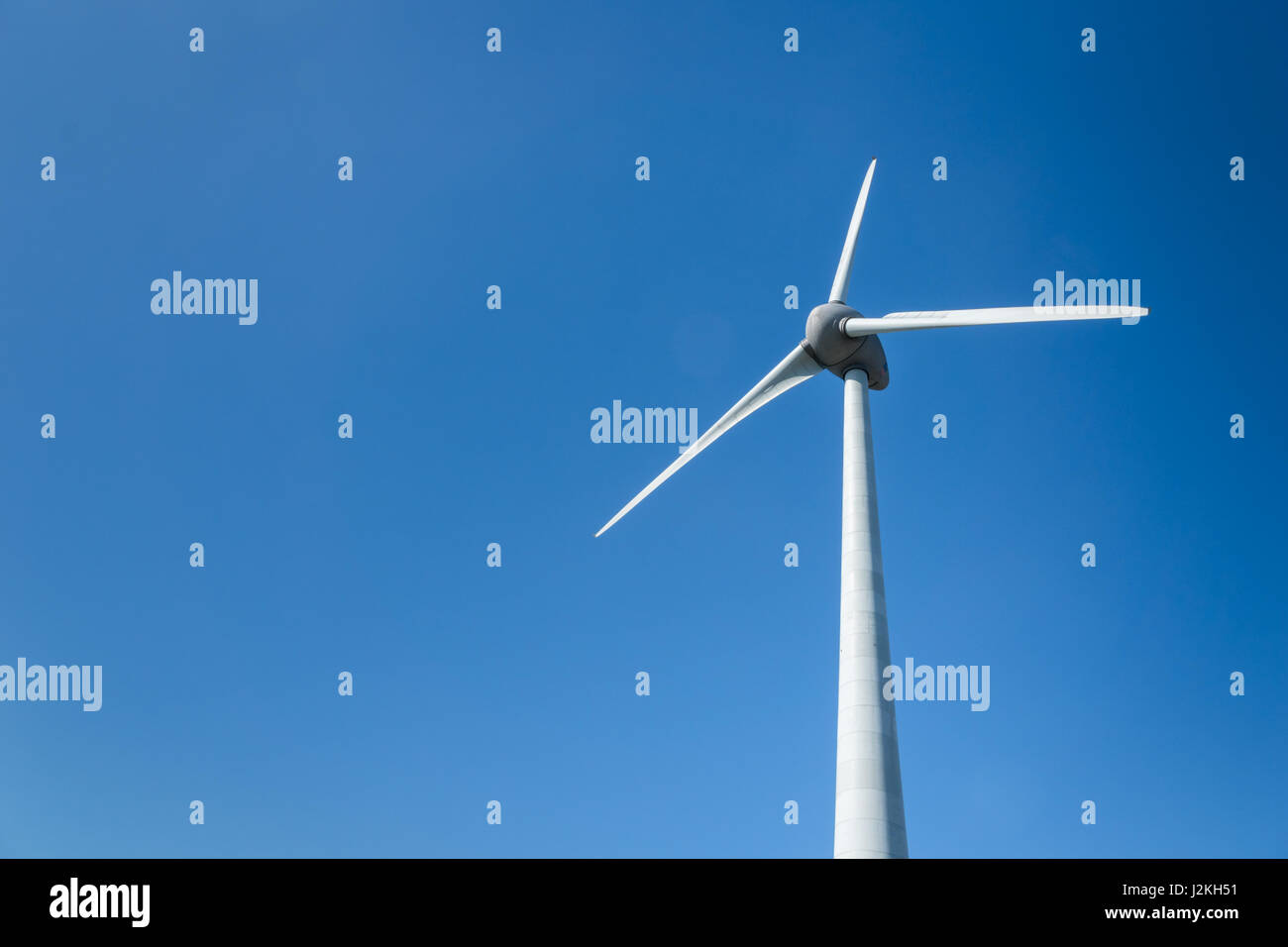 wind energy turbine / modern wind mill against blue sky background Stock Photo