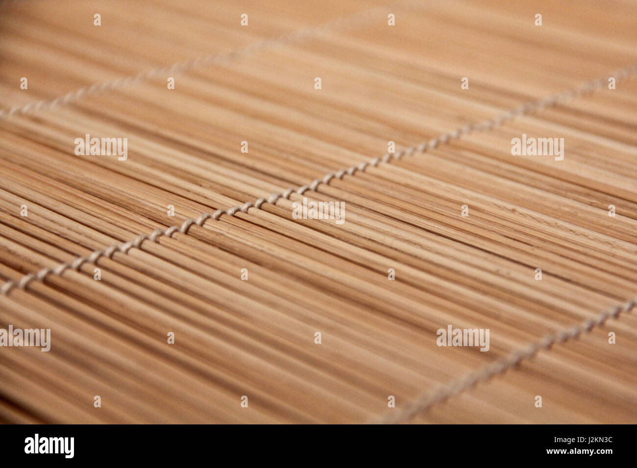 Closeup from structured tablecloth, placemats with light. Backlight with ambiente. Stock Photo