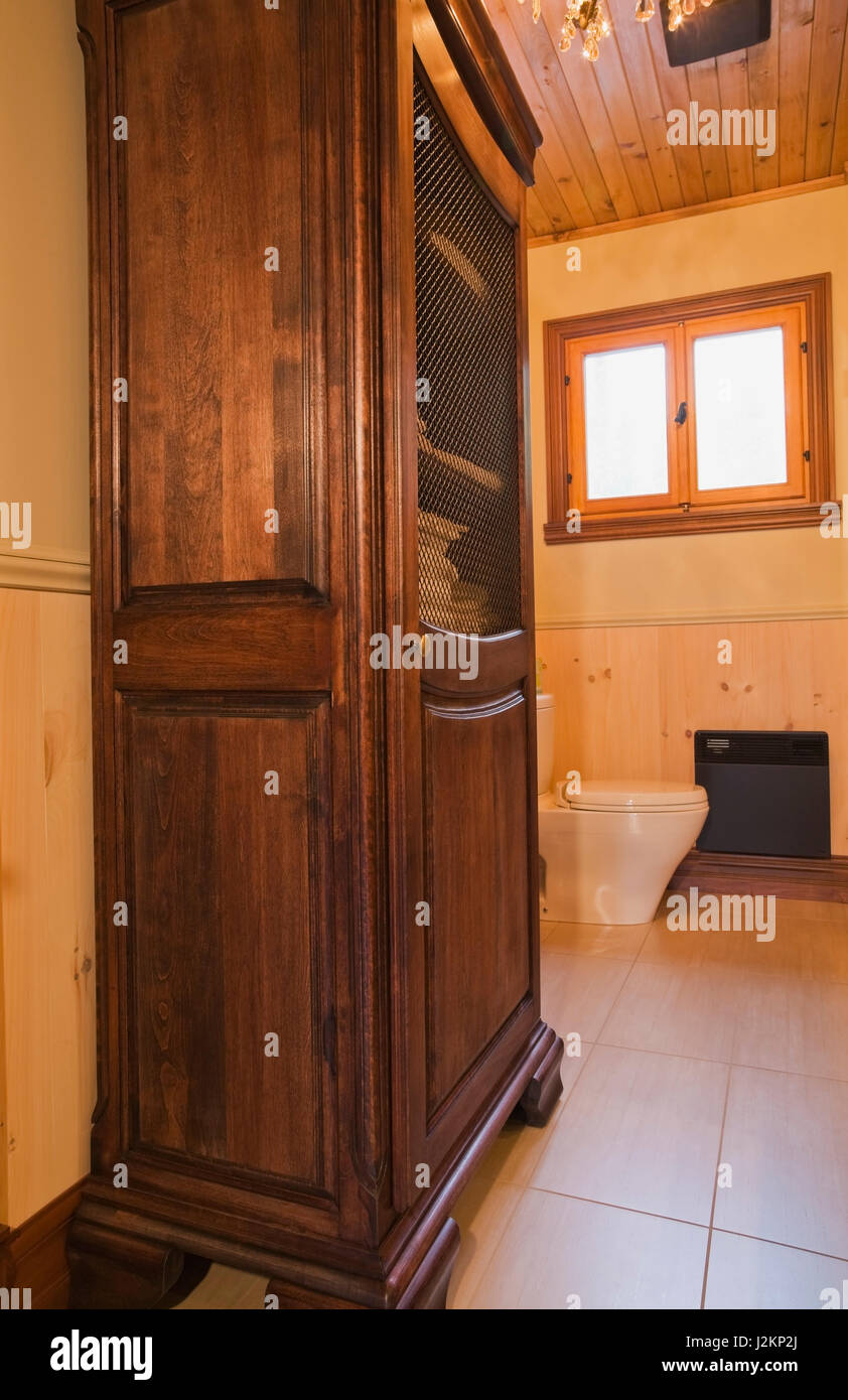 Antique Wooden Linen Cabinet With Wire Mesh Door And Toilet In Main  Bathroom Inside A Cottage Style Flat Log Profile And Timber Home