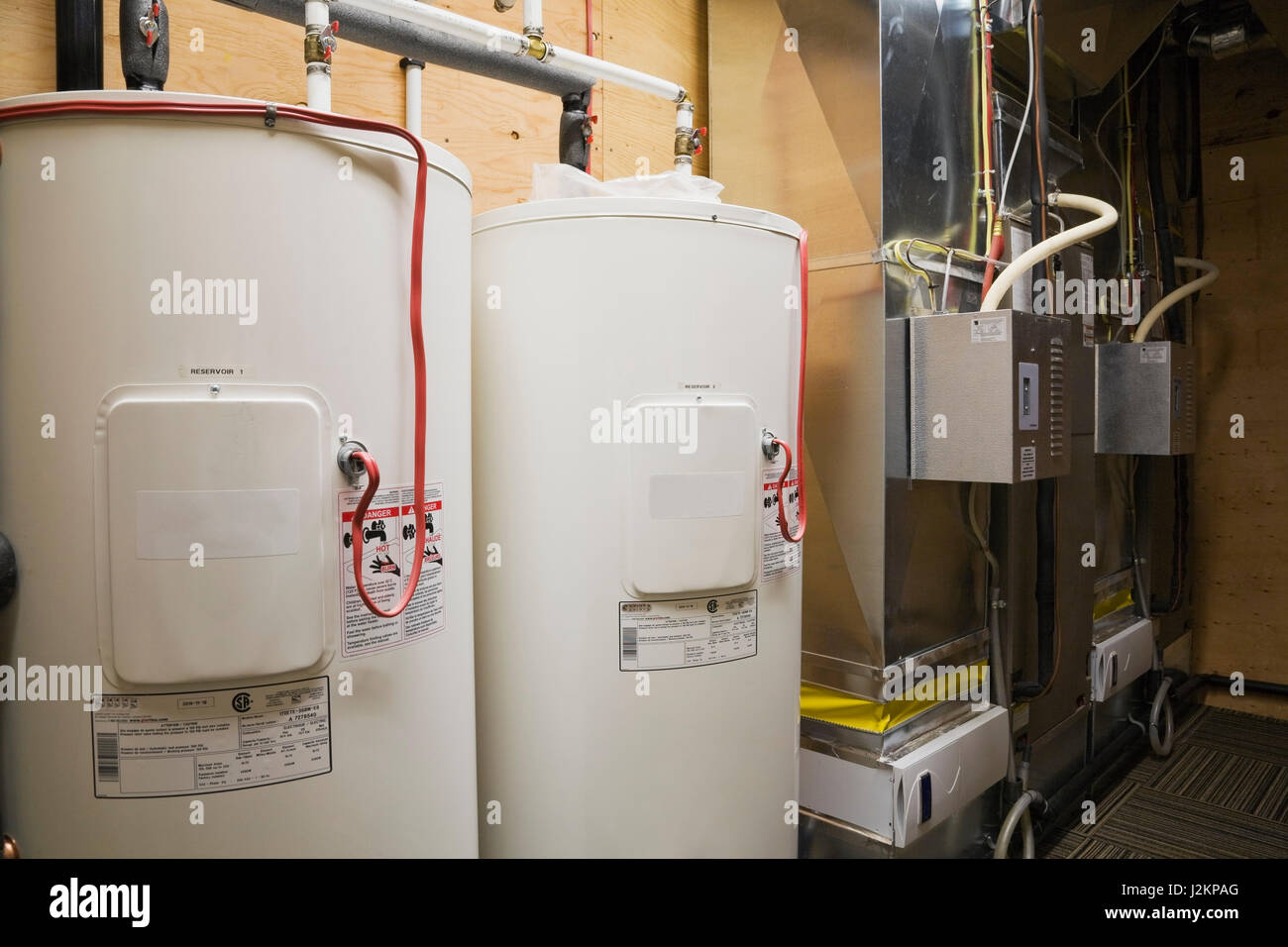 Water heating tanks and furnace in utility room in the basement inside a luxurious Scandinavian log and timber cottage style home. & Water heating tanks and furnace in utility room in the basement ...