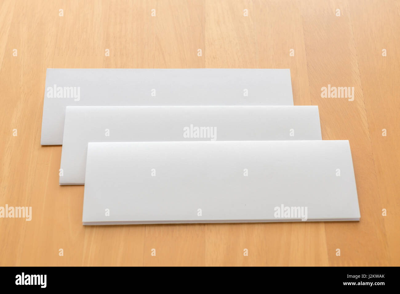 four fold white template paper with wooden clipboard on wood stock