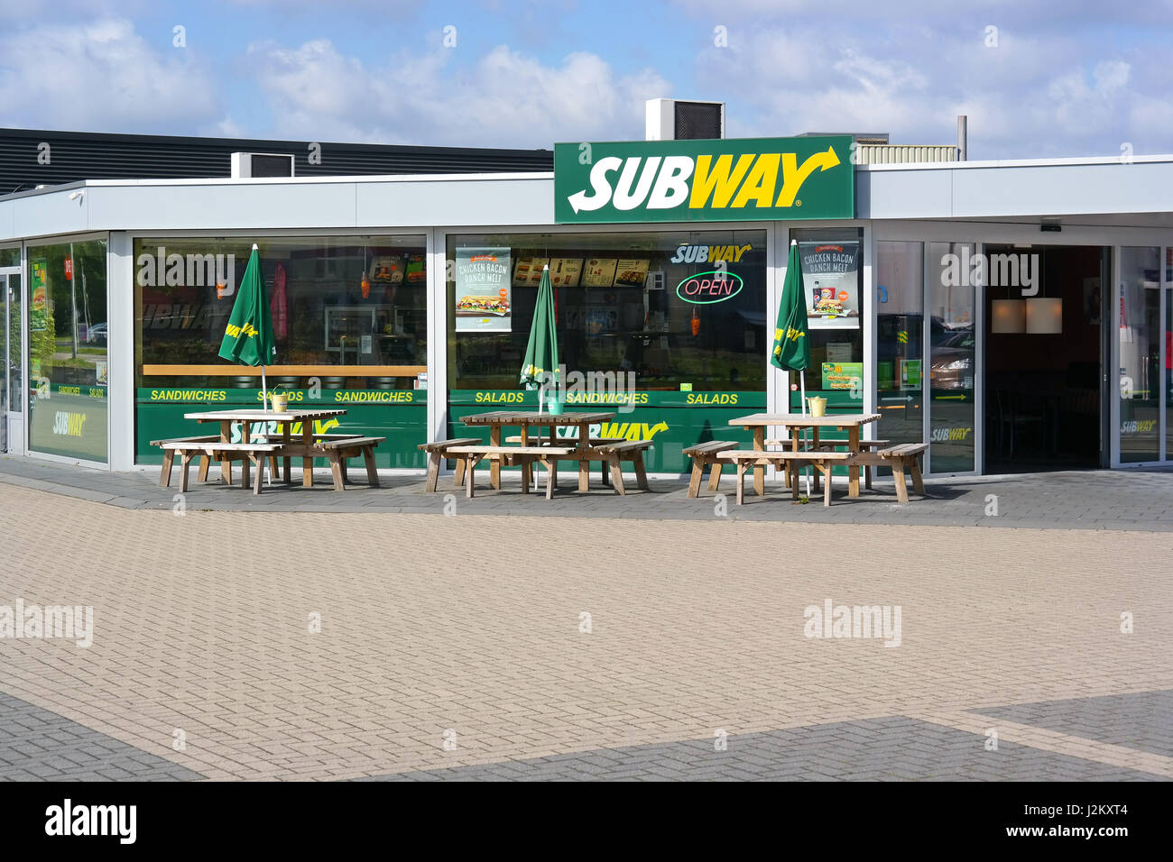 Unoccupied sidewalk cafe of a Subway Restaurant - Stock Image