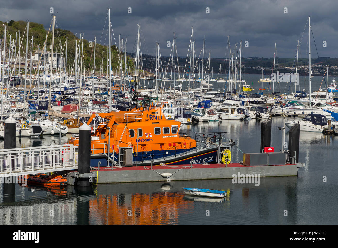 View across Brixham Harbour and Marina, with the RNLI Torbay lifeboat moored, in South Devon, UK - Stock Image