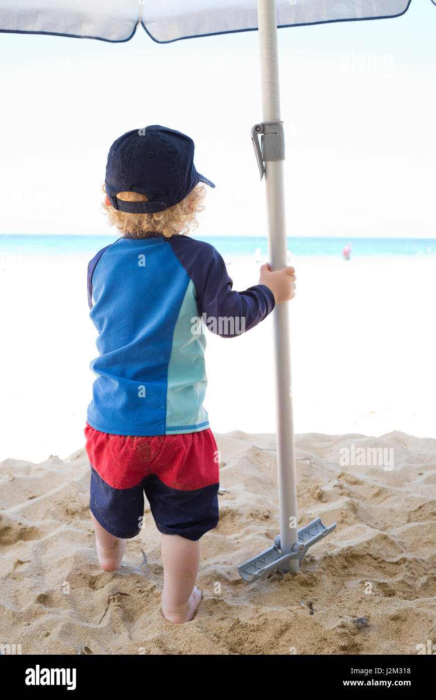 Toddler on the beach - Stock Image