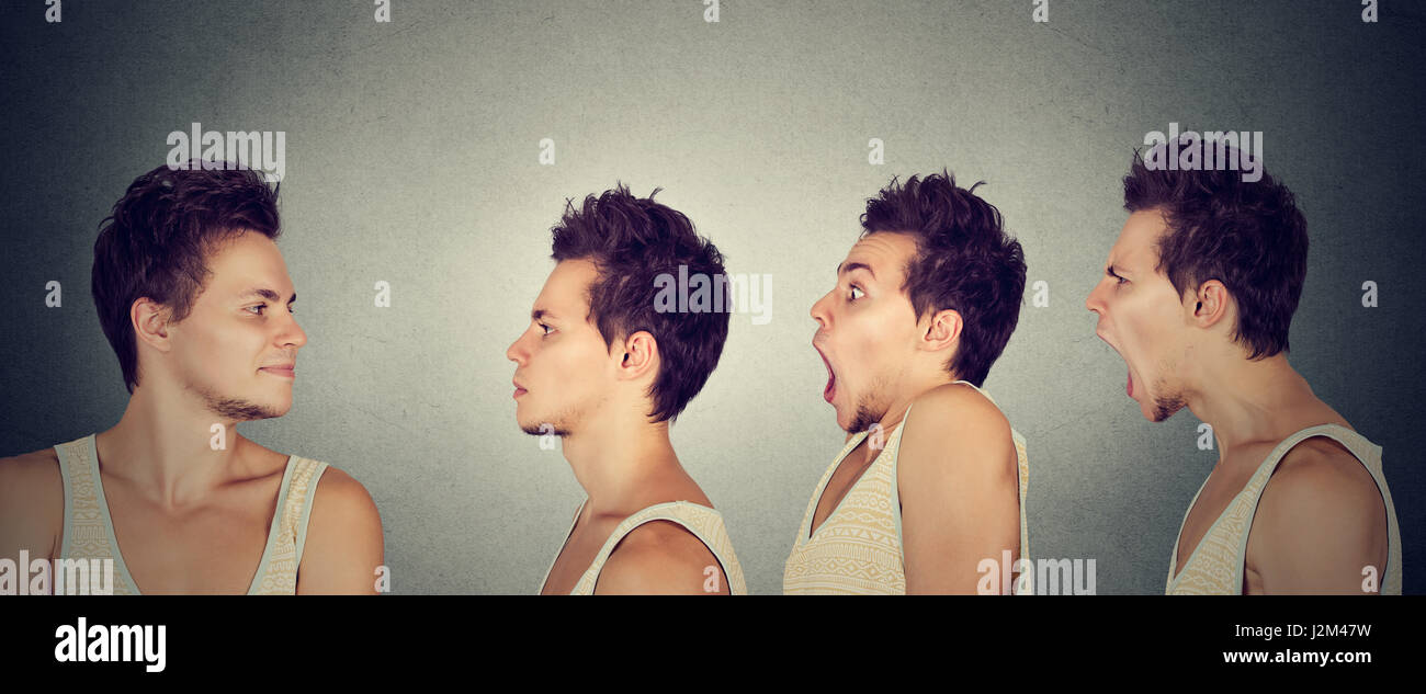 Emotional intelligence stress perception concept. Happy young man looking at himself expressing different emotions - Stock Image