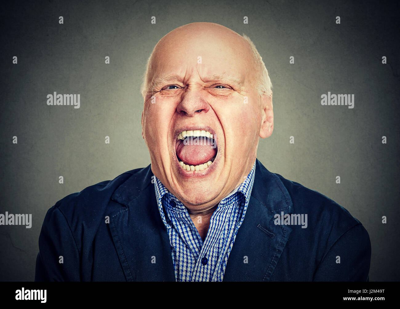portrait of senior angry man - Stock Image