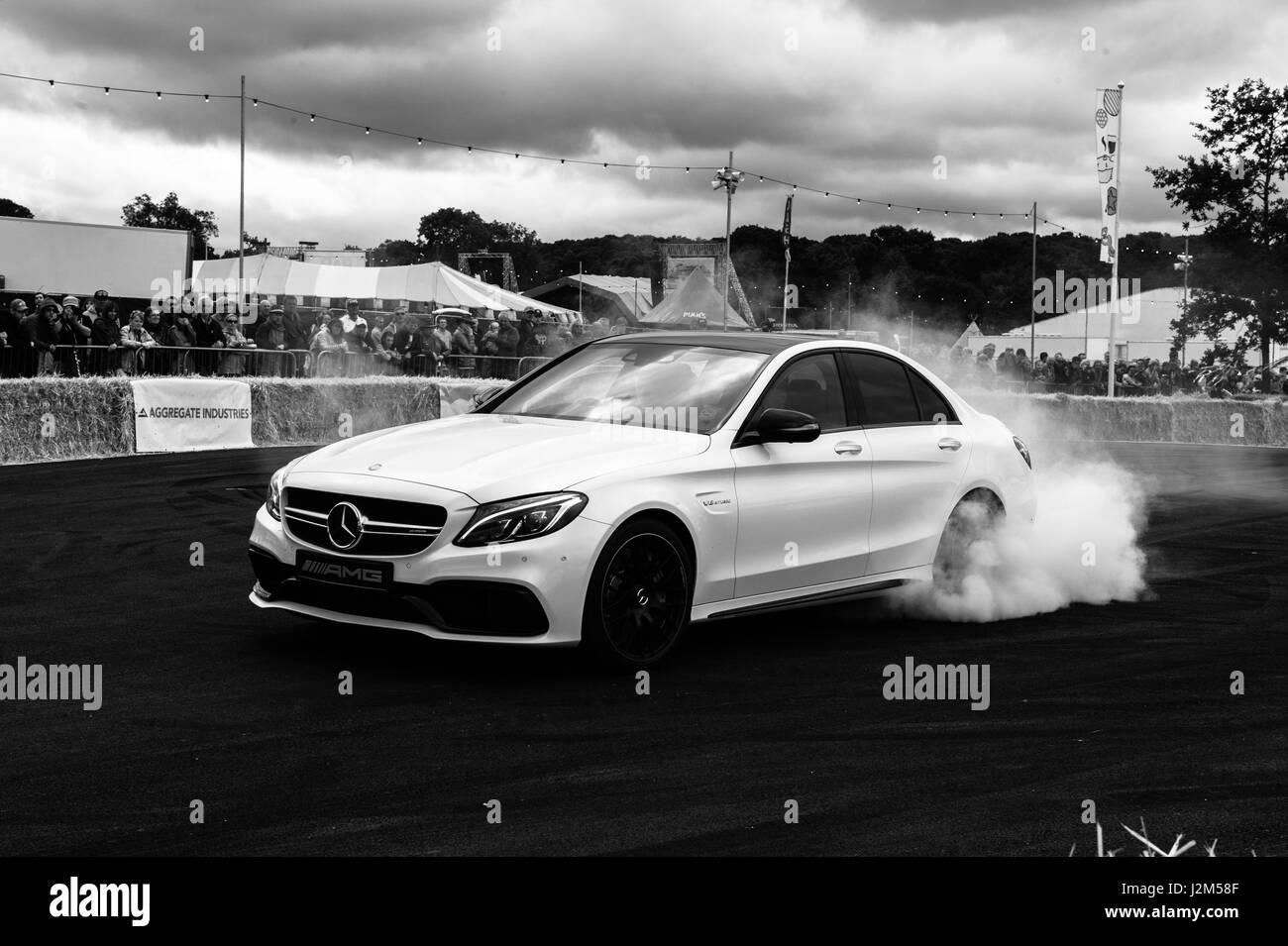 Laverstoke Park Farm, Overton, Basingstoke, Hampshire, United Kingdom. 28 August 2016. Mercedes AMG C63 burnout Stock Photo