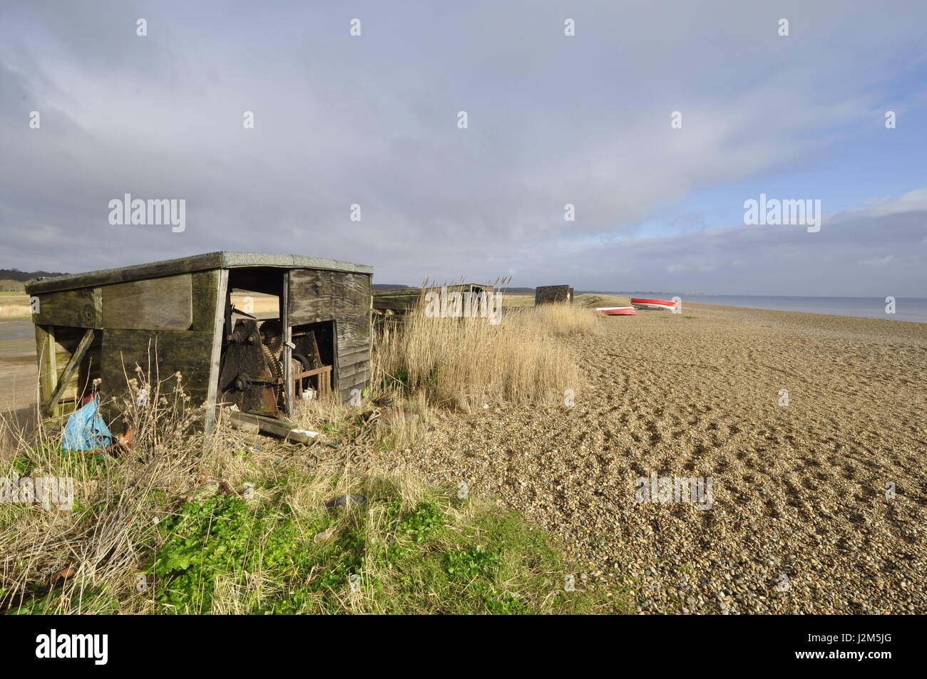 disused boat hauling gear shed on Dunwich beach, Suffolk, UK Stock Photo