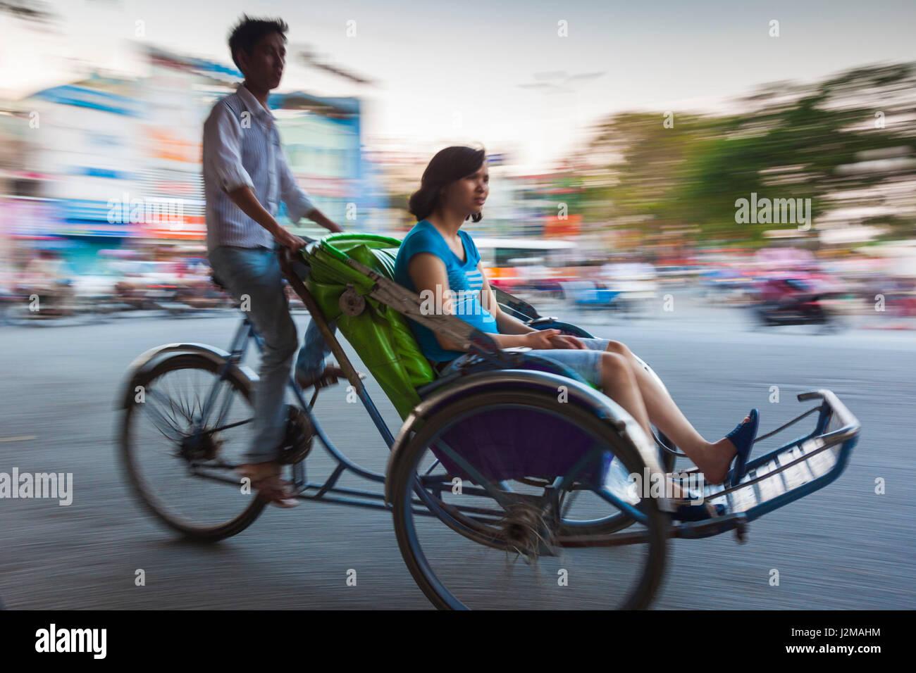 Vietnam, Hue, street traffic, cyclo, motion blur - Stock Image