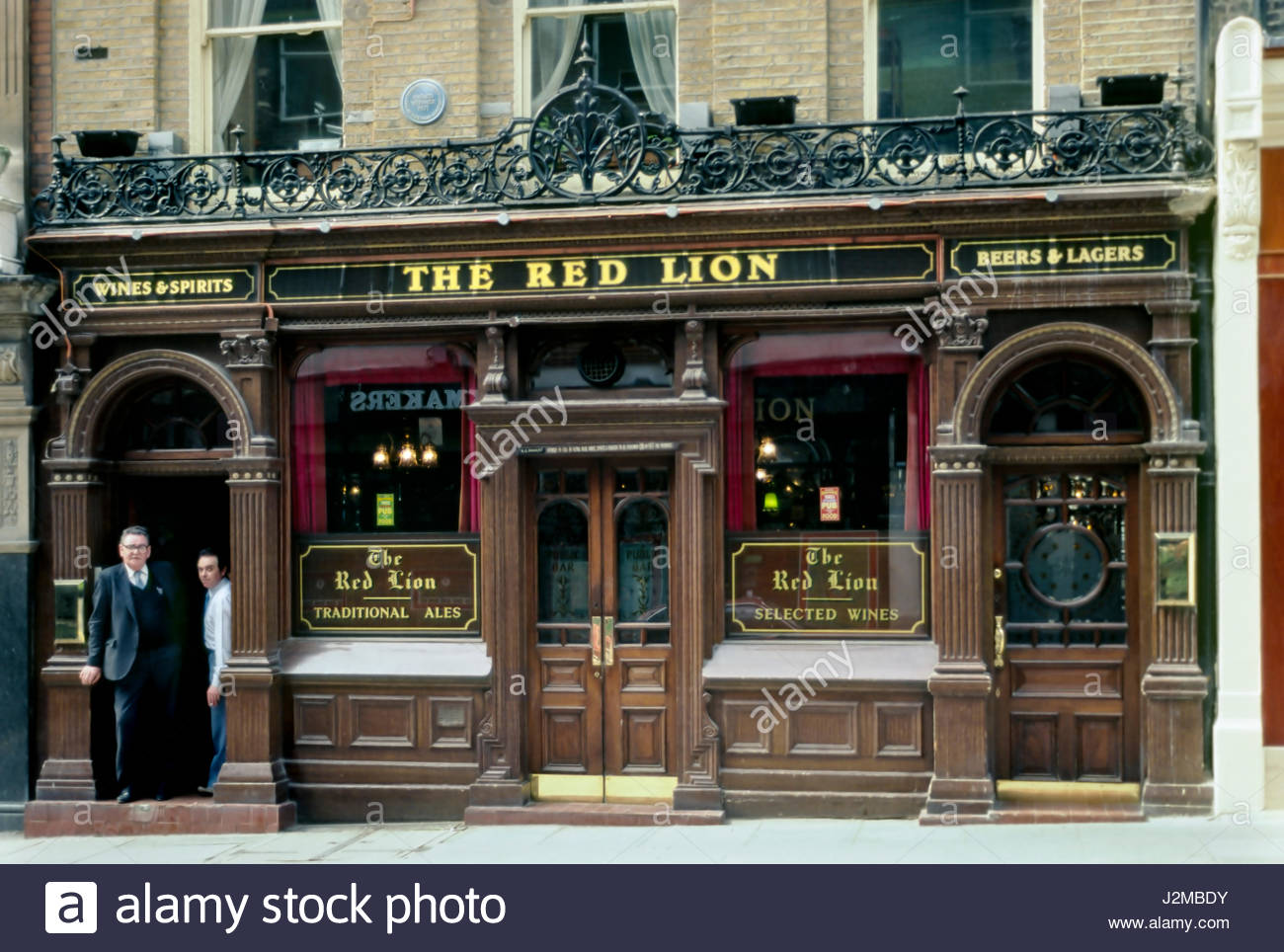Duke of York, St. James's, London, England, United Kingdom. Two men standing in the doorway under the sign for - Stock Image