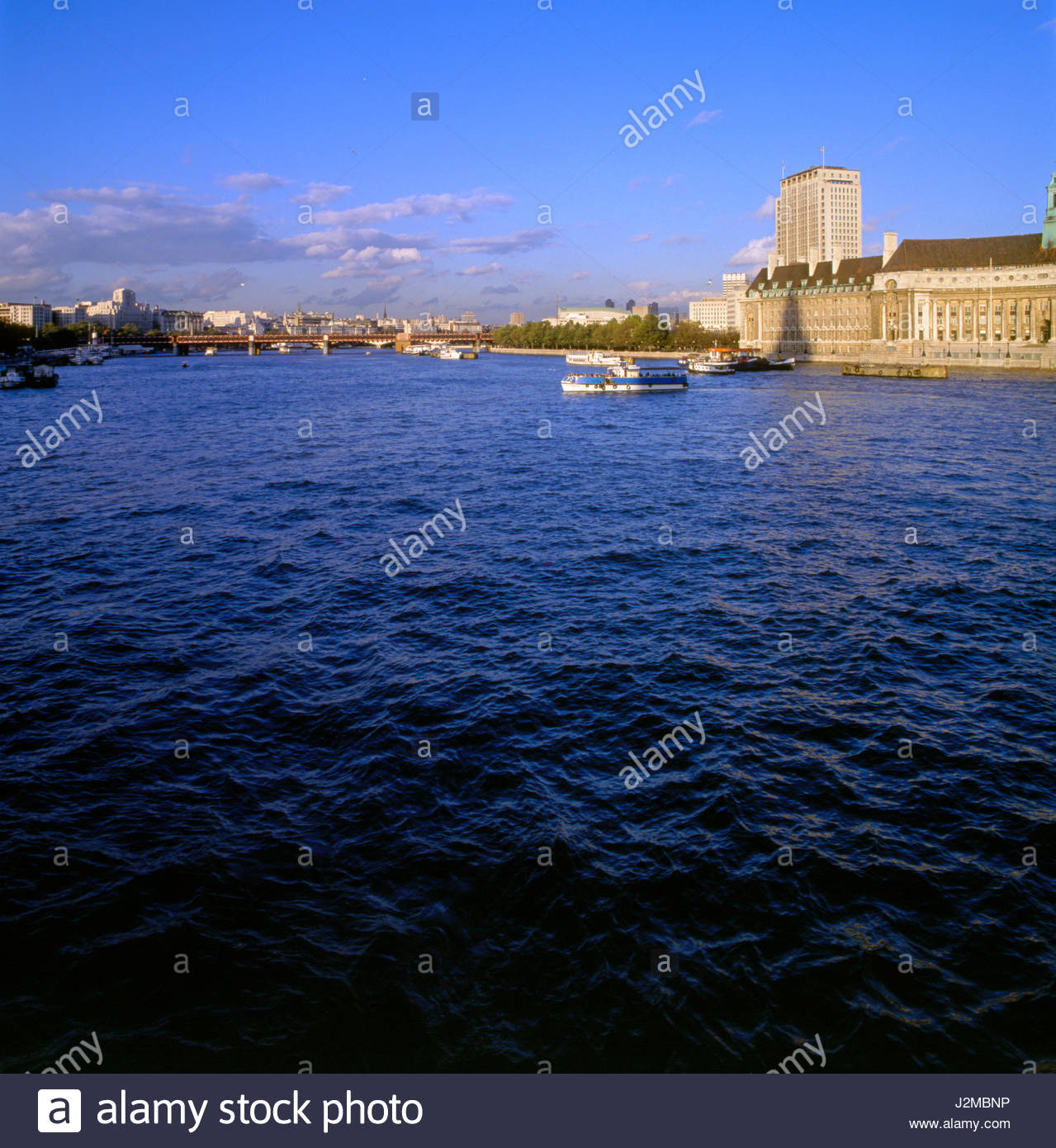London, England, United Kingdom. The County Hall (on the right) along the Albert Embankment, River Thames. County - Stock Image