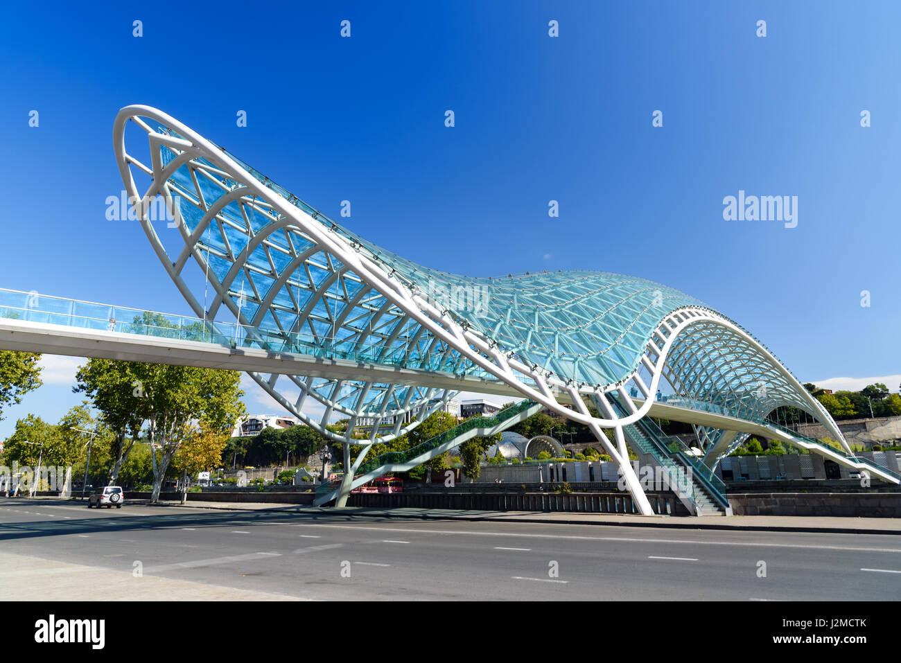 Tbilisi, Georgia - September 27, 2016: Bridge of Peace over the Kura River Stock Photo