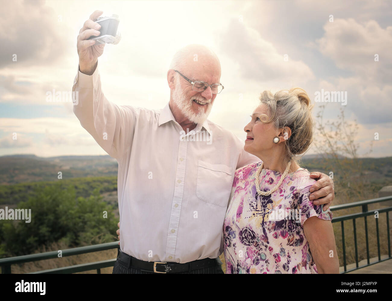 Old couple taking a selfie Stock Photo