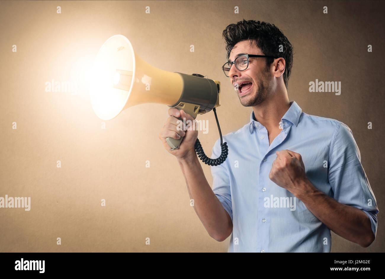 Man yelling with megaphone - Stock Image