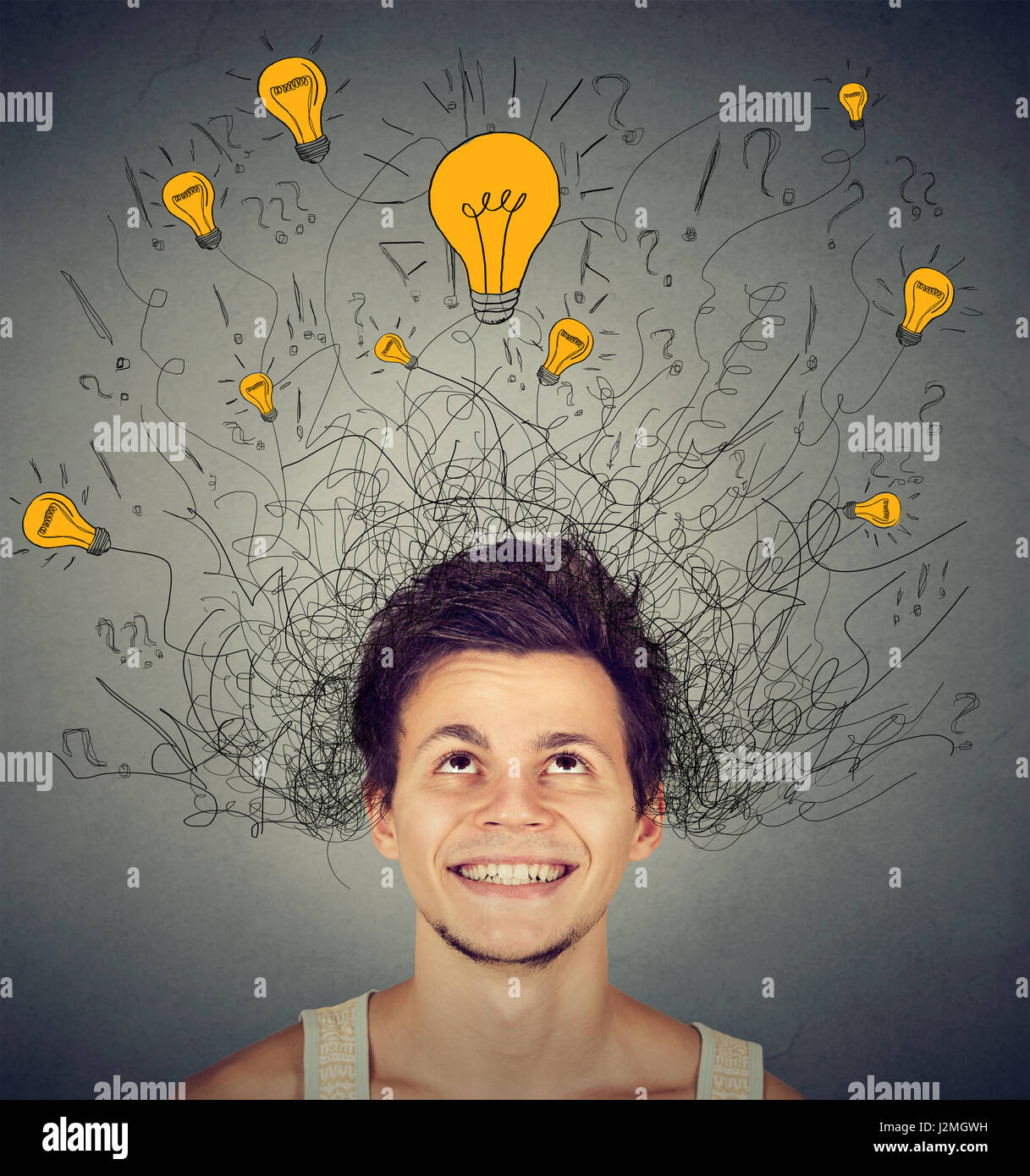 Young man with light bulbs over his head - Stock Image