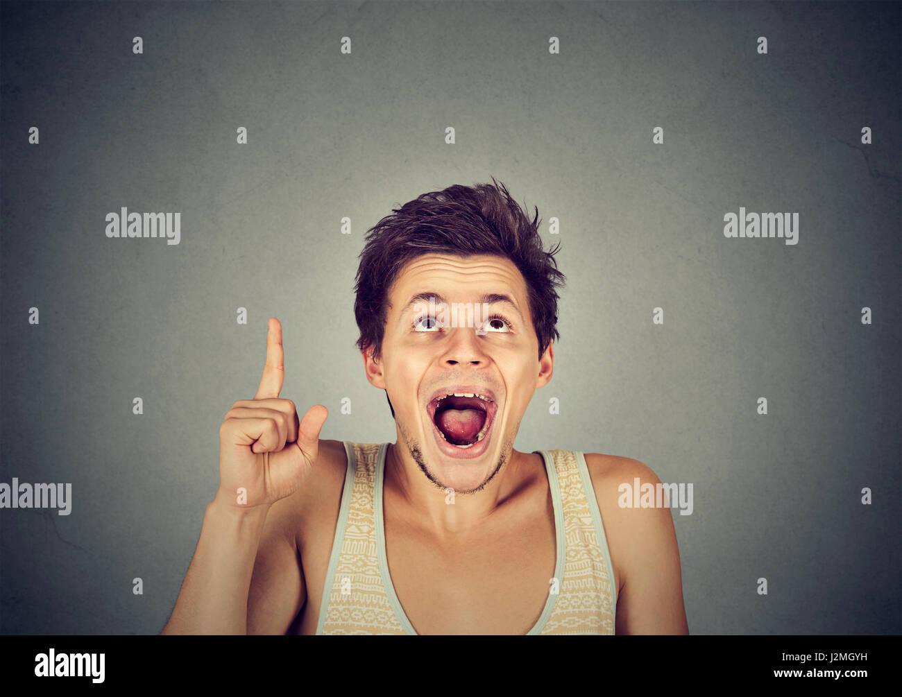 Headshot man having good idea aha thought pointing index finger up solution found isolated on grey background. Human - Stock Image