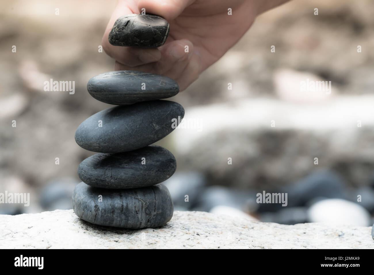 All the successful have a good support,  zen stone, balance, rock, peaceful concept - Stock Image